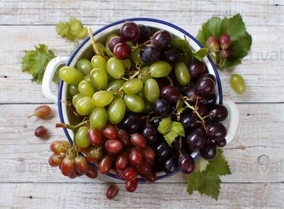 White, red and blue grapes  in a bowl