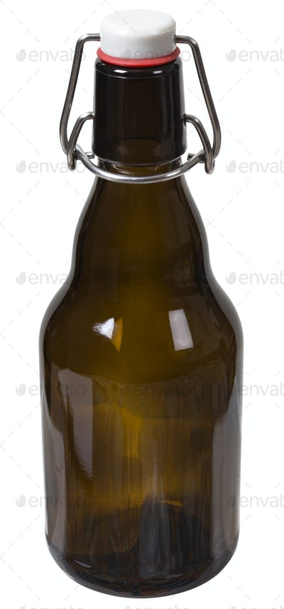 Empty glass bottle with the closed cap hold isolated