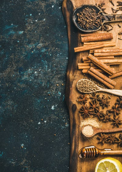 Ingredients for making gluhwein on wooden rustic board, copy space