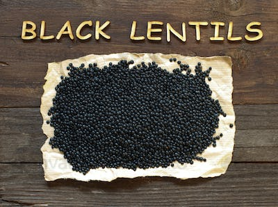 Pile of Black Lentils with a wooden word