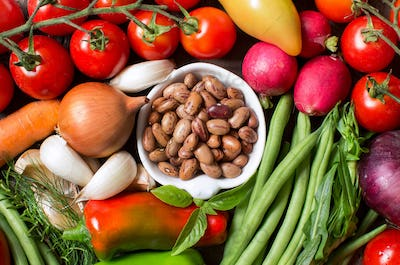 Pinto beans in a bowl with fresh vegetables