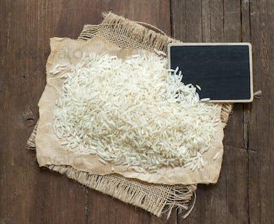 Basmati raw rice on wood with a small chalkboard
