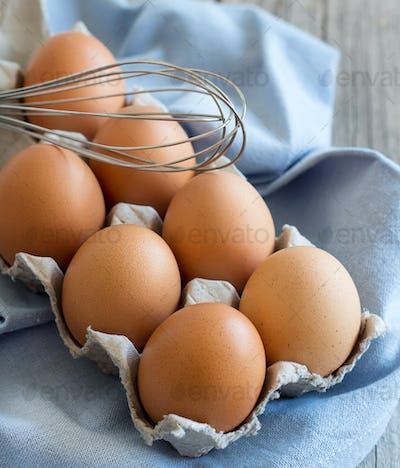 Chicken eggs and whisk