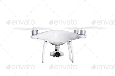 Flying helicopter drone with camera. Studio shot, isolated.