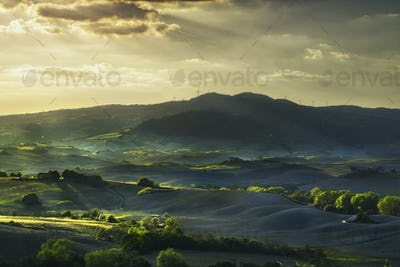 Tuscany, rolling hills on sunset. Rural landscape. Green fields