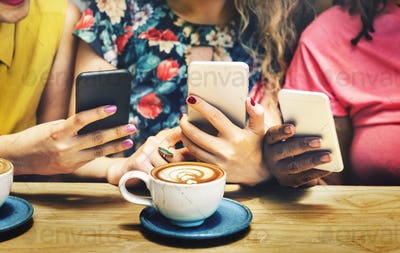 Group of Women Drinking Coffee Using Smart Phone Concept