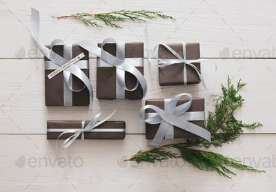 Top view of christmas present boxes on white wood background