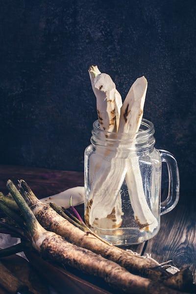 Horseradish roots in jar