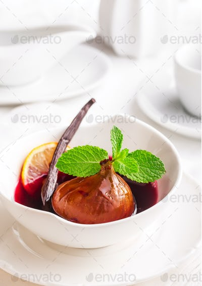 Poached fig in red wine with vanilla and mint