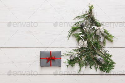 Christmas background. Gift boxes on fir tree at white wood