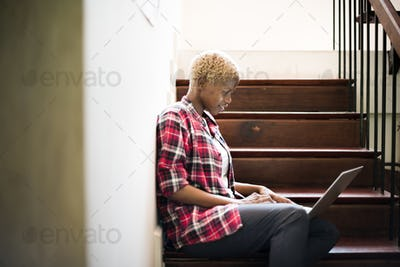 African Woman Laptop Social Networking Stairway Concept