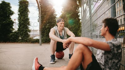 Streetball players taking rest after playing a game.