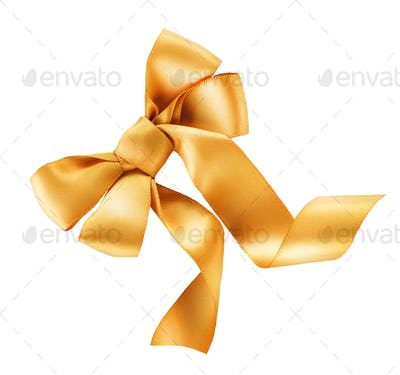 Bow. Golden satin gift bow. Ribbon. Isolated on white