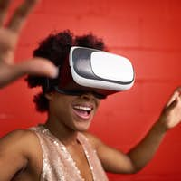 Cool millennial black woman exploring space with virtual reality