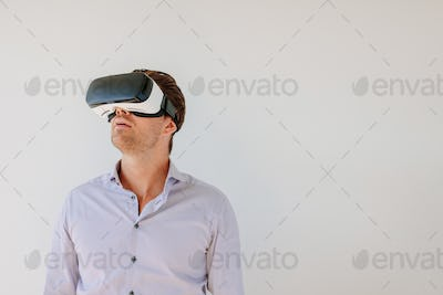 Man with VR headset looking away at the objects