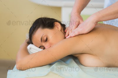 health, beauty, resort and relaxation concept - beautiful woman with closed eyes in spa salon