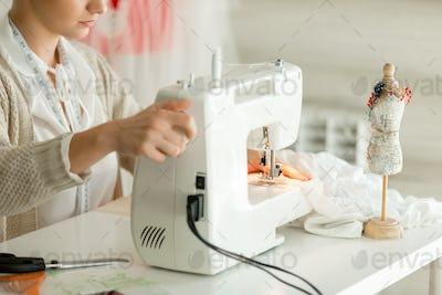 Woman at a sewing machine