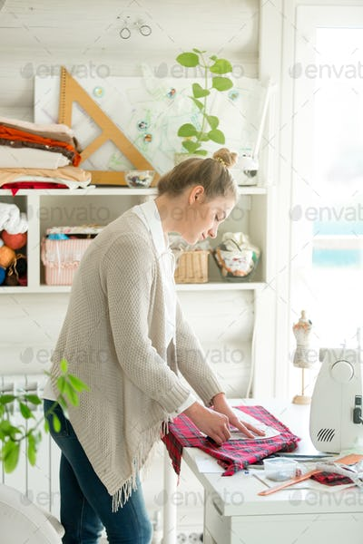Portrait of an attractive woman working with a sewing pattern