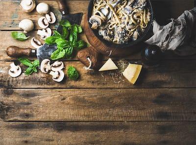 Homemade creamy mushroom pasta spaghetti with parmesan and basil