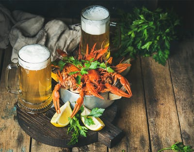 Wheat beer and boiled crayfish with lemon, fresh parsley