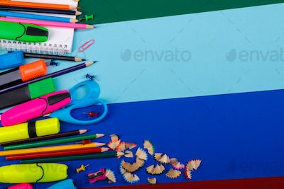 School or office stationery on colorful background.