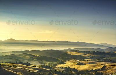 Tuscany Maremma foggy morning, farmlands and green fields. Italy
