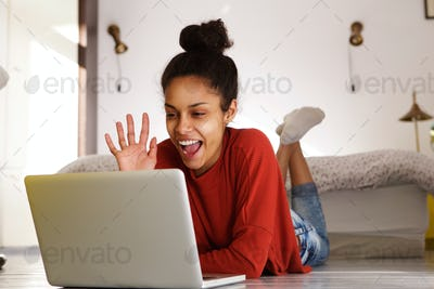 Smiling woman making video call on laptop