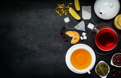 Red and Yellow Tea with Ingredients on Copy Space