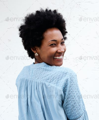Smiling young black woman looking back