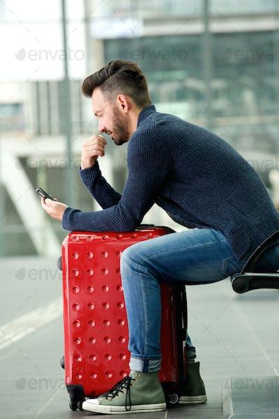 Mature man waiting at train station
