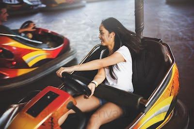 Girl Driving Bumper Car Happiness Enjoyment Concept
