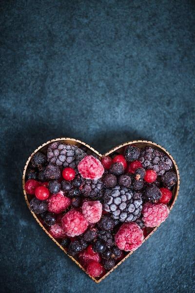 Frozen berries in heart symbol