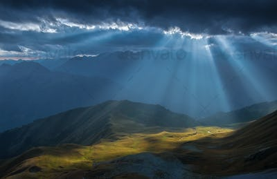 Mountain valley in beams of evening sun.