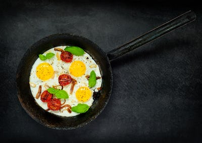 Fried Eggs in Cooking Pan