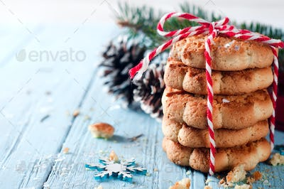 Christmas fir tree with cookies and decoration on a wooden board