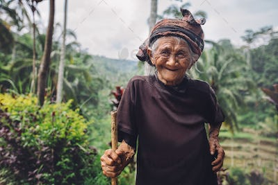 Old woman with beautiful smile in countryside