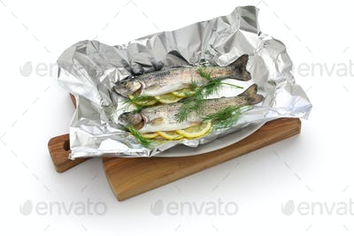 whole rainbow trout baked in foil (before oven baking).