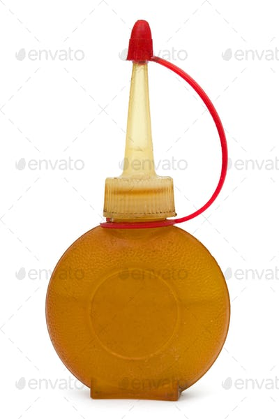 Old bottle of lubricating machine oil, isolated on white backgro