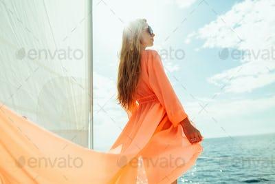 sexy woman in swimwear pareo yacht sea cruise vacation