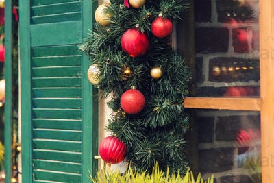 Christmas Red ball decorated windows on vintage house