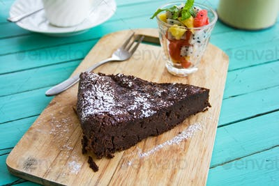 Chocolate cake with fruits salad