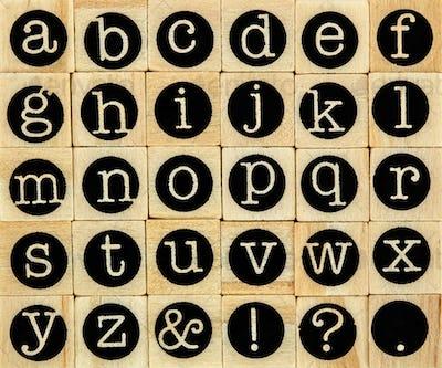 English alphabet lowercase, background of isolated wood letterpr