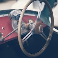 Close up on steering wheel, Classic car interior