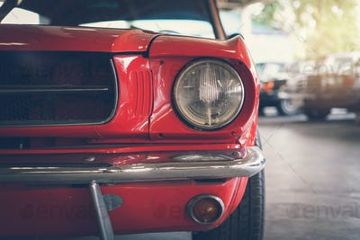 Close up headlight of red Retro classic car