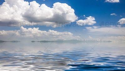 sea and cloudy blue sky