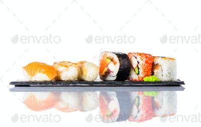 Sushi Rolls with Smoked Salmon on White Background