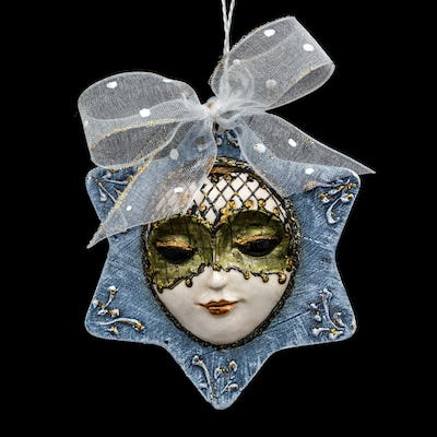 Beautiful mask of hand-worked for festive decoration, isolated