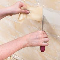 removing backing from the wall before wallpapering