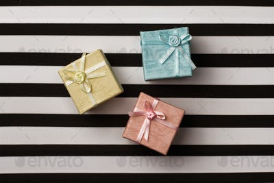 small gift boxes on stripes paper background