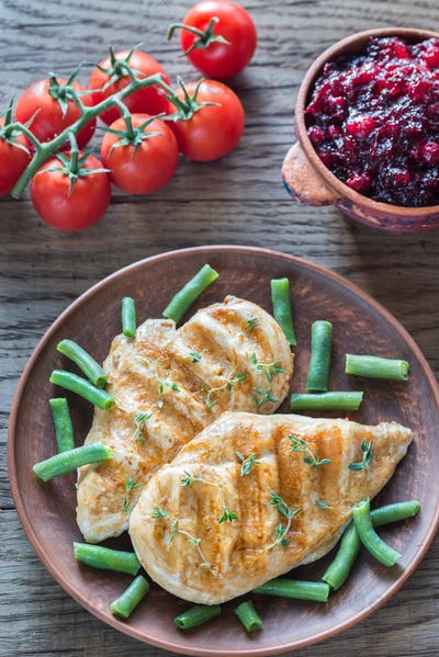 Grilled chicken with green beans and cranberry sauce